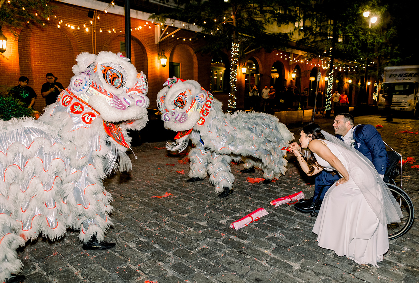 """We included a Vietnamese Dragon dancer at the end with firecrackers to bring good luck into our marriage,"" shares Gina."