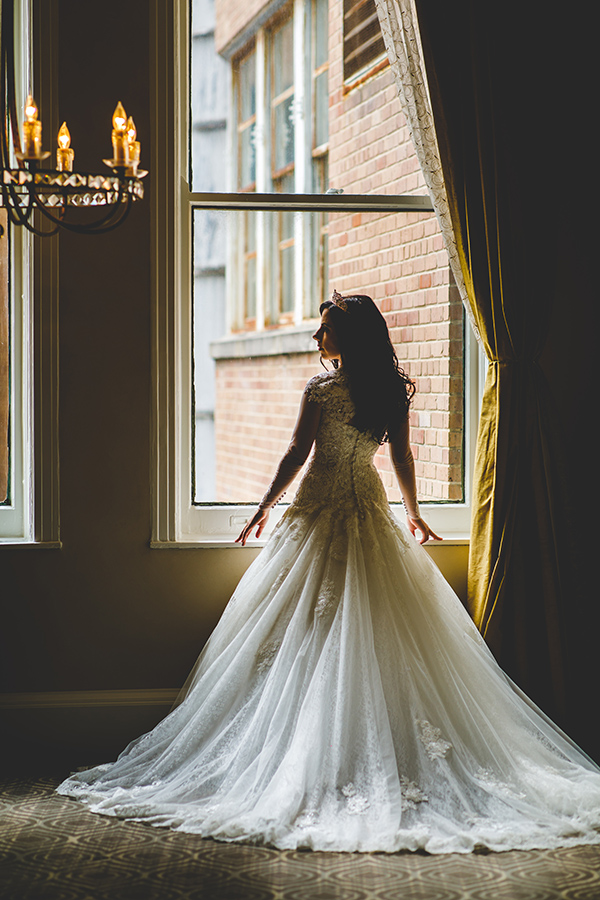 Jess wore an Essense of Australia gown from MaeMe The Bridal Boutique, customized with illusion sleeves with lace details.