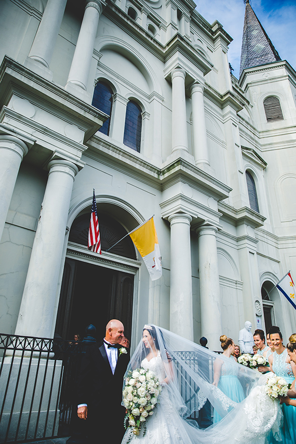 Jess pauses with her father and bridesmaids before her grand entrance at St. Louis Cathedral in New Orleans French Quarter.