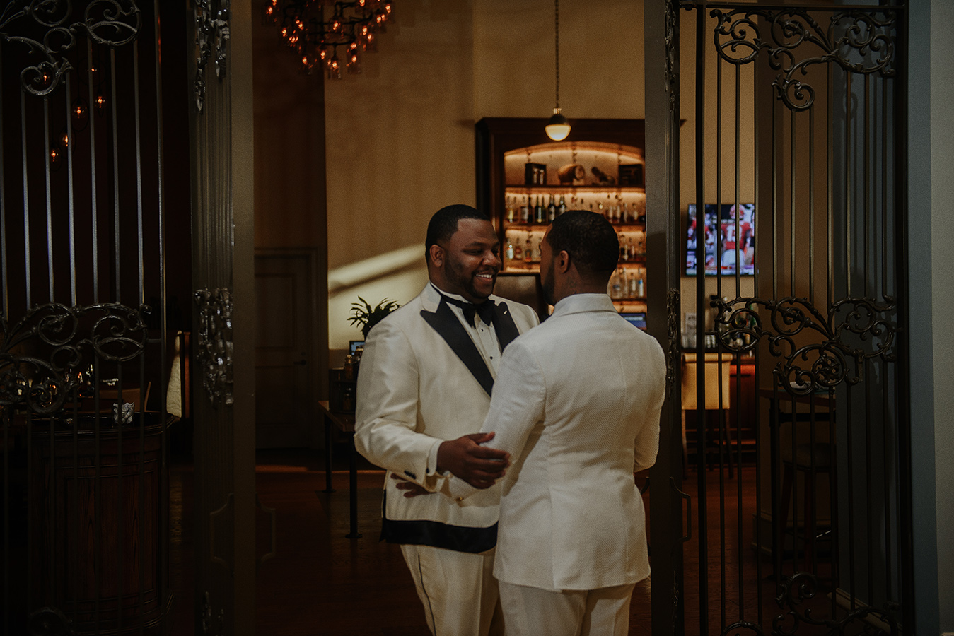 """Our first look was a mix of emotions - being nervous, the anticipation of what each other's suits looked like, and trying not to do the ugly cry,"" shares Ay'Jae. ""But when we saw each other we were like 'umm you clean up very well' with a huge smile on both our faces and we couldn't stop hugging."""