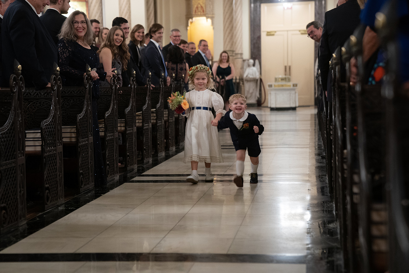 "The couples didn't have a ring ""bear""er, but a ring ""dinosaur"" according to Margaret's 3-year-old nephew George, who stomped up the aisle like a dinosaur with the flower girl, Margaret's niece, Caroline."