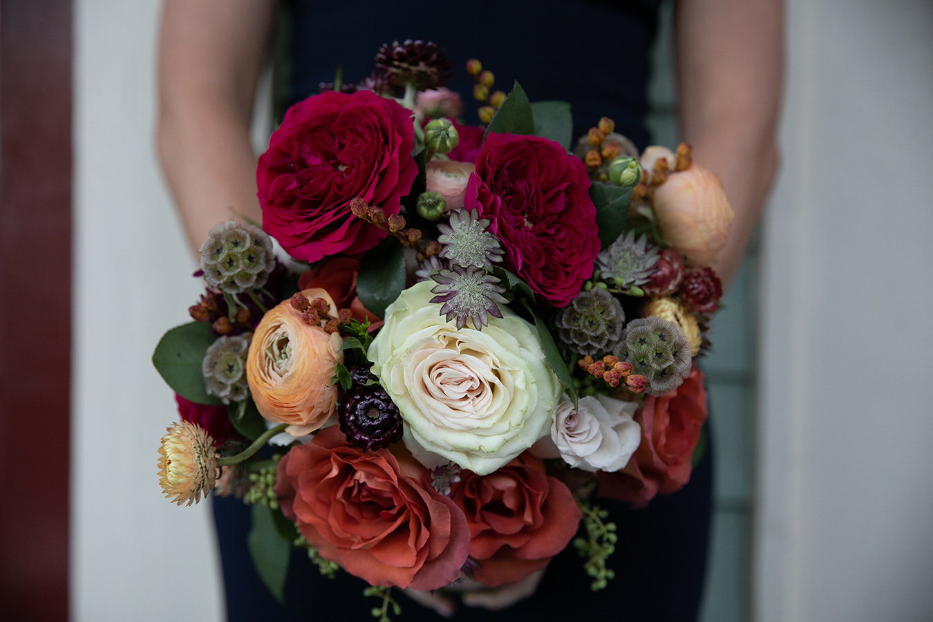 Florist Meade Wenzel used beautiful fall colors in the wedding bouquets.
