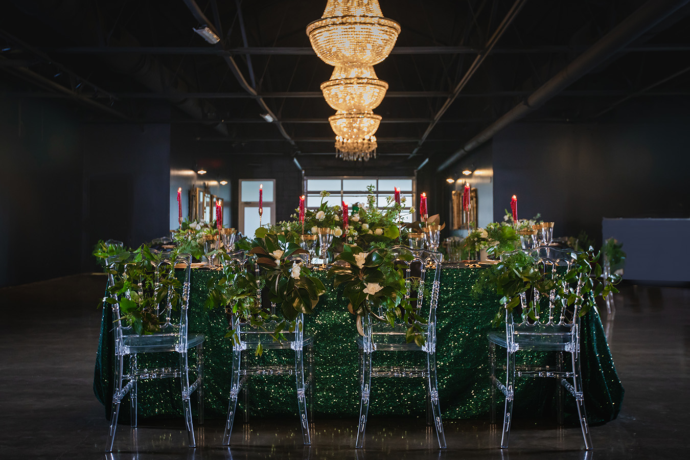 Wedding reception table at The Parlor at The Pontchartrain Hotel featuring green sequin linen and clear Napoleon chairs. Photo by: Brian Jarreau Photography