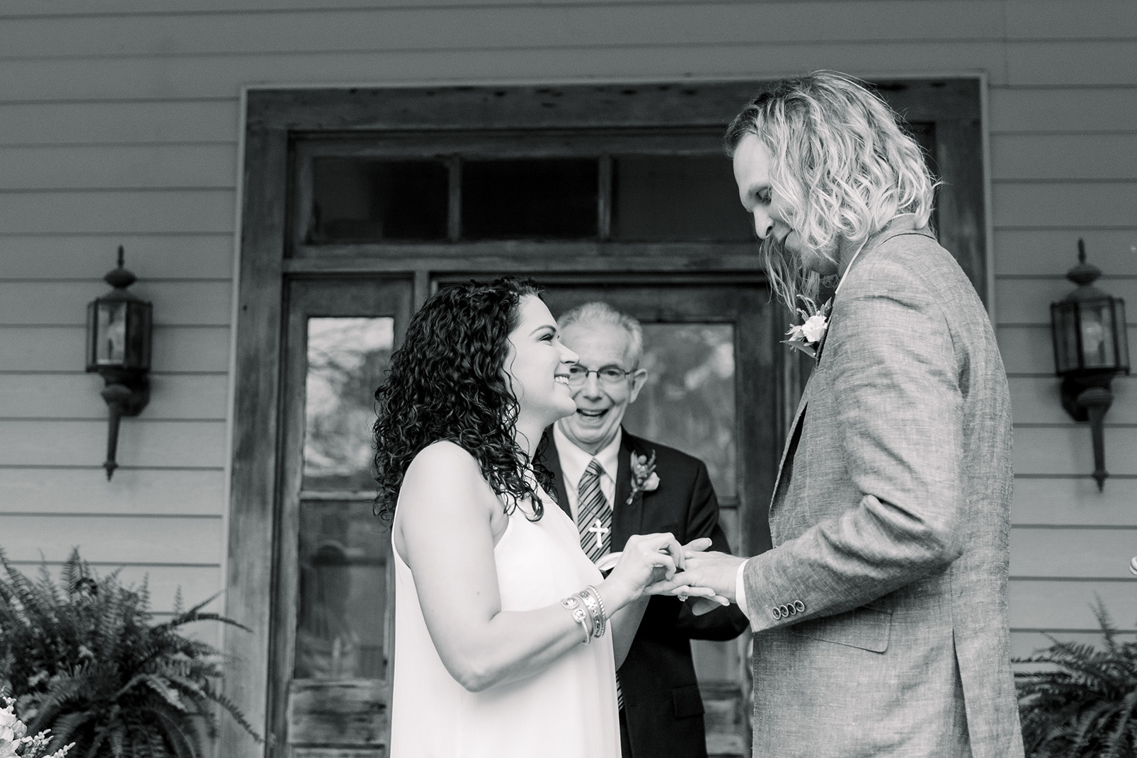 Chelsea and Wesley exchange vows on their original wedding date. Photo by Sarah Alleman Photography.