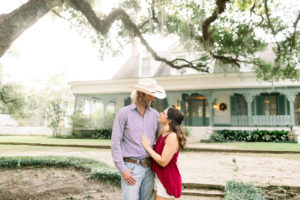 Chelsea Richard and her fiance Wesley pose for engagement photos at The Myrtles in St. Francisville, Louisiana. Photo by Sarah Alleman Photography.