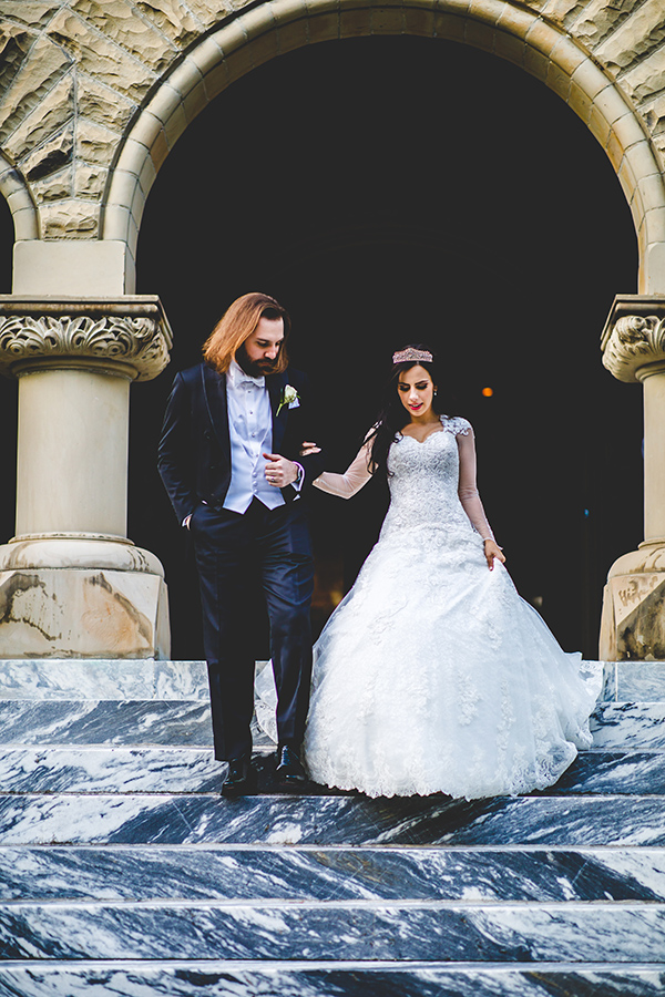 After the ceremony, the couple posed for photos with their bridal party at the W.P. Brown Mansion on St. Charles Avenue. The 22,000 square foot Romanesque Revival home was built in the early 1900s and is filled with ornate architectural details and opulent antiques, including the footboard of a bed that is believed to have been owned by Marie Antoinette.