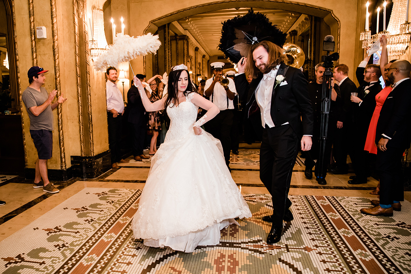 The couple treated their guests to a traditional Second Line parade from the Roosevelt rooftop to the Waldorf Astoria Ballroom.
