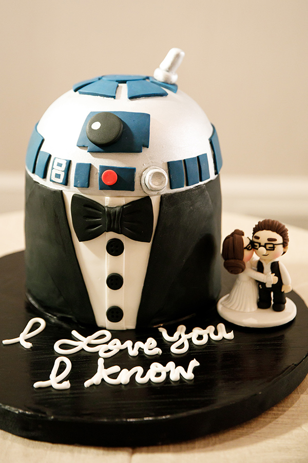 Star Wars fan, Rhett, was treated to a red velvet groom's cake styled as R2-D2 in a tuxedo.