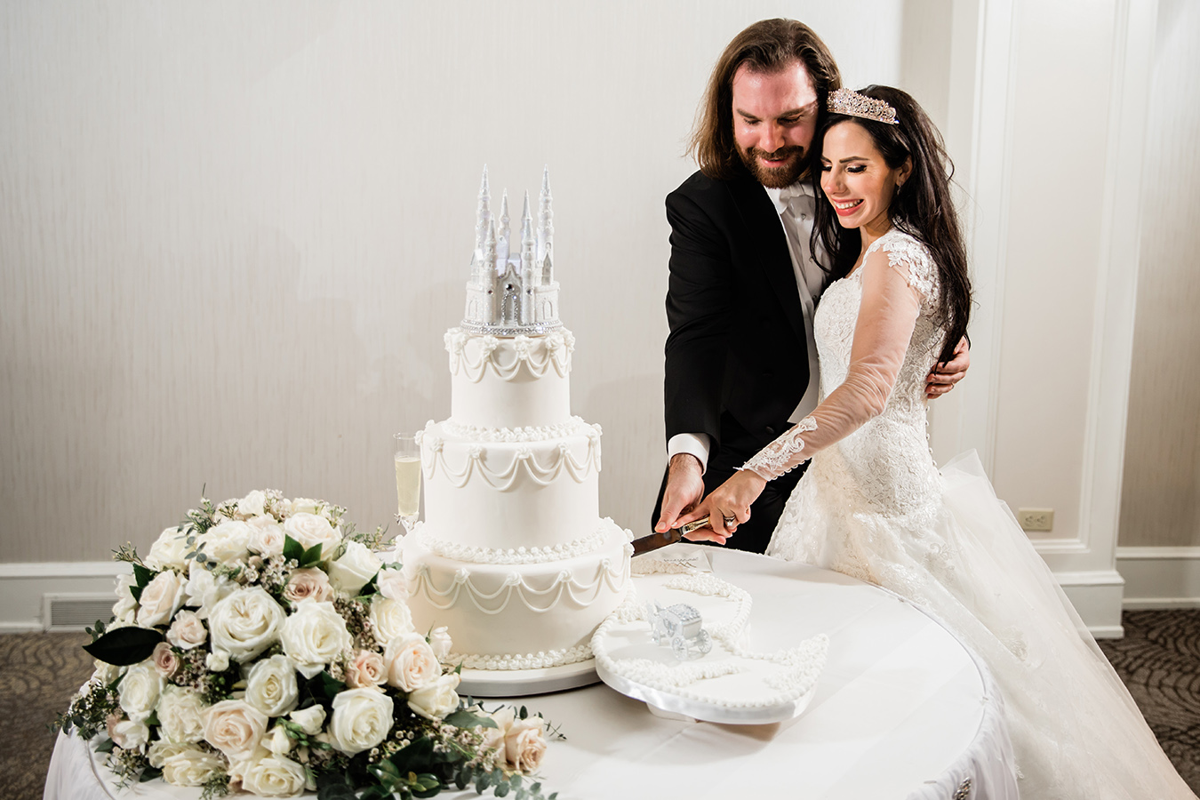 Jess' 3-tier wedding cake was fit for a princess - complete with a castle and royal carriage! - and featured decadent flavor profiles, including white velvet and apricot champagne and Italian cream and pistachio.