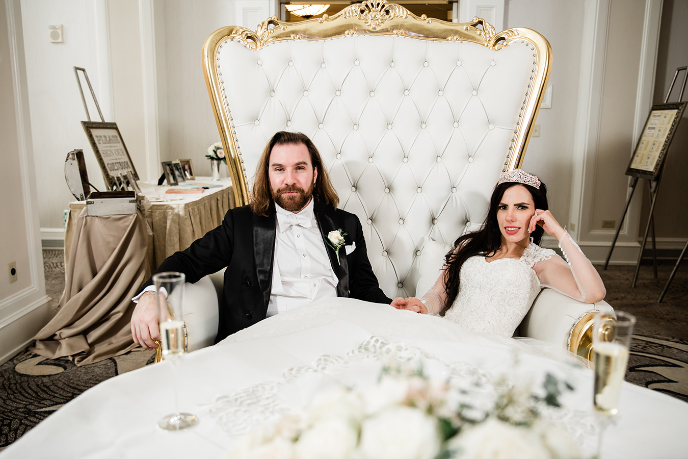 Jess and Rhett's sweetheart table featured an elegant white and gold Baroque throne loveseat from ELEMENT.