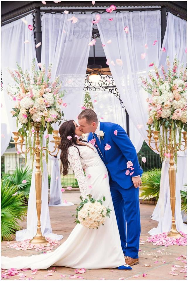 Newlywed's kiss at their wedding ceremony in Chateau Golf and Country Club's gazebo. Photo: Lindsey Tassin