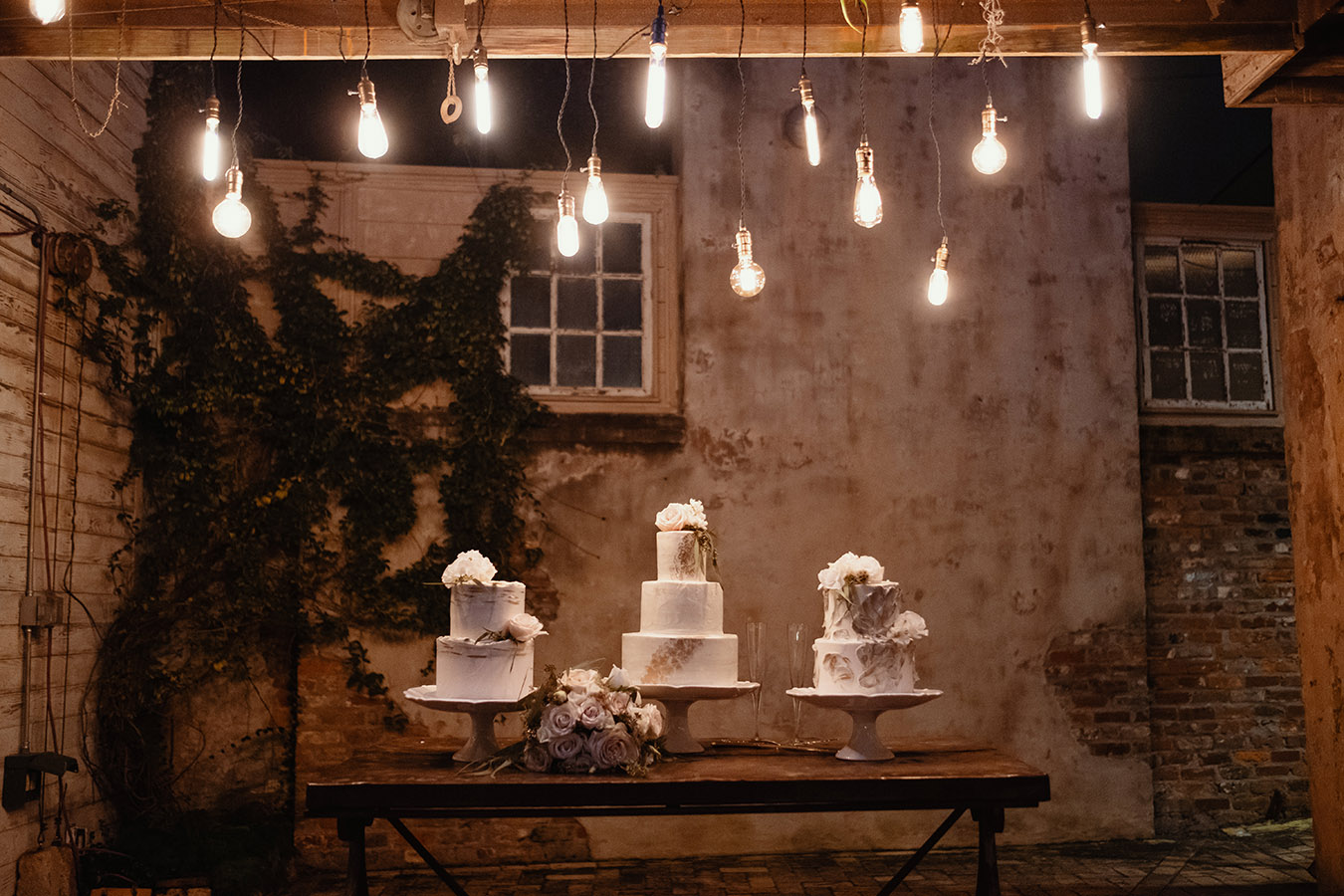 Frosted Fantasies by Nikki created three cakes that each mimicked the architectural details of the venue, such as the plaster on the wall behind the cake table.