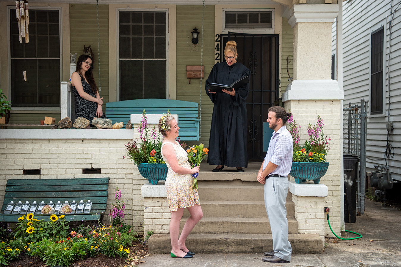 Elizabeth and Greg's ceremony took place on the front porch of their house in Treme with Diane Lundeen officiating.