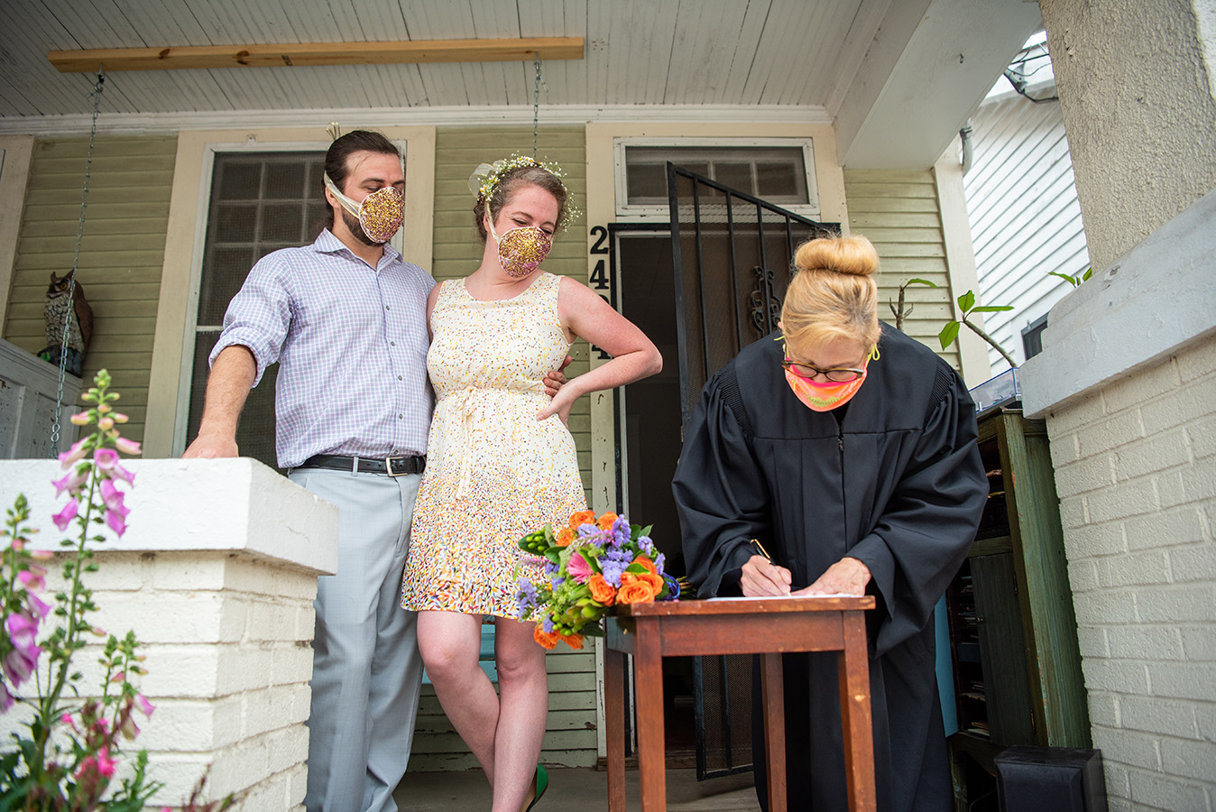 "Elizabeth's biological mother dropped off a wedding present for the couple on their porch prior to the wedding: ""two fully functional n-95 masks covered in glitter, courtesy of my step-dad, that proceeded to shed glitter everywhere like magic pixie dust through the entire ceremony,"" shares Elizabeth."