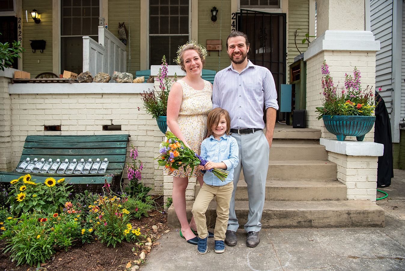 After the ceremony, the newly weds pose for photos with their four-year-old son, Frank.