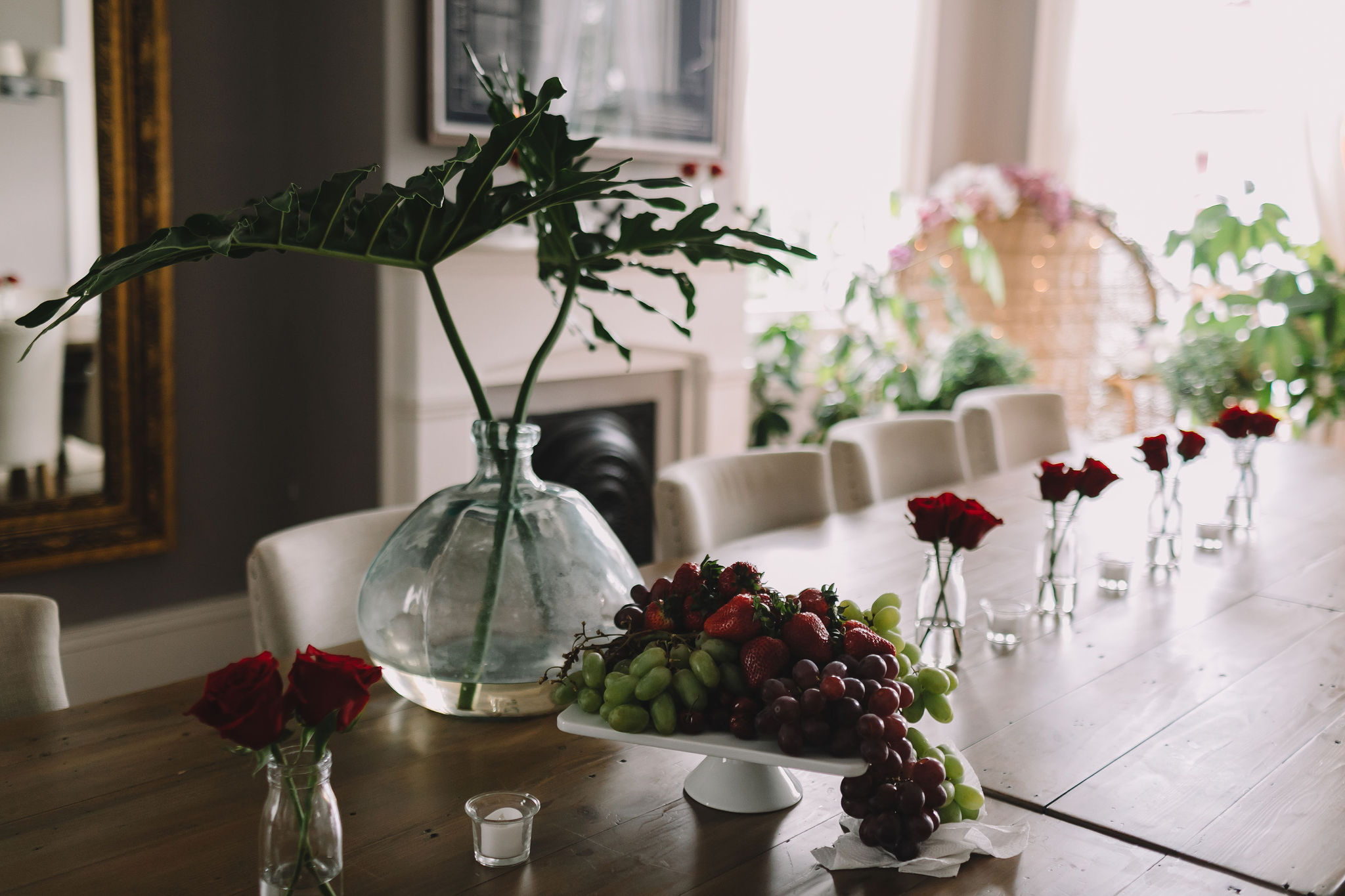 Simply beautiful! Red roses in bud vases decorate the dining table at The Mazant where Morolake and Will's wedding festivities took place.