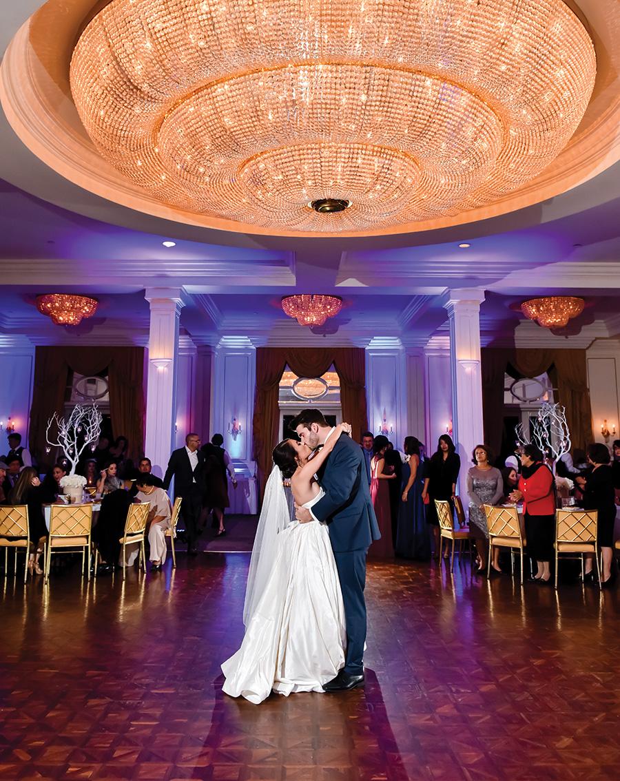 Wedding first dance under the chandelier in Chateau's ballroom. Photo 1216 Studio