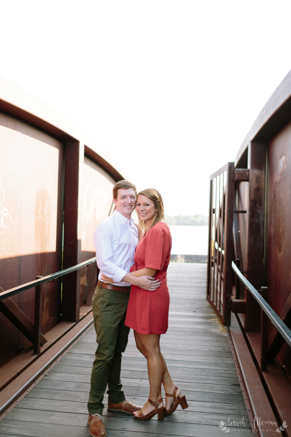 The Mississippi Riverfront is a beautiful backdrop for engagement photos. | Photo by Sarah Alleman Photography
