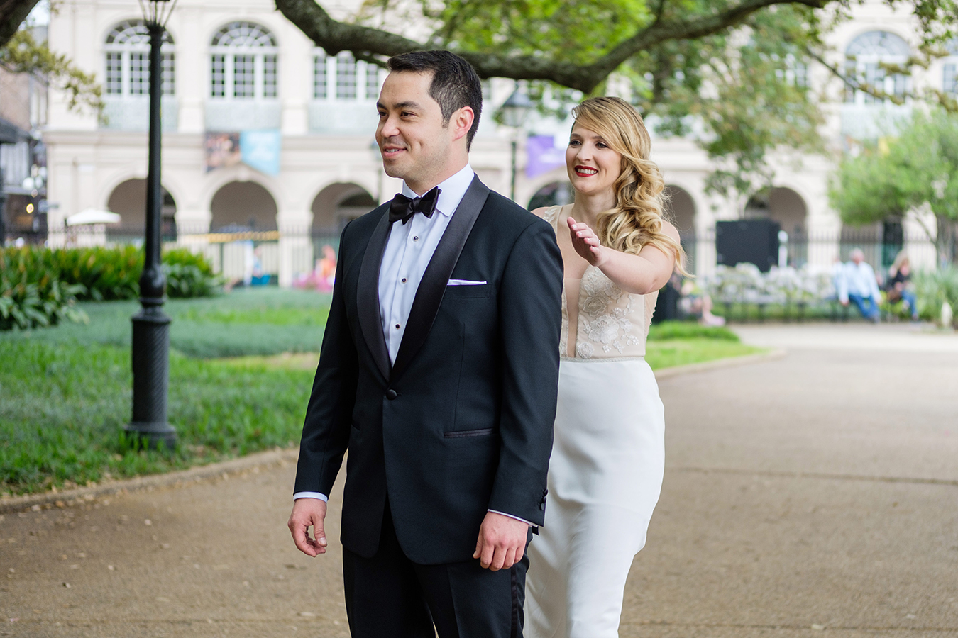"Alex and Greg planned a ""First Look"" in Jackson Square and then spent time taking photos together with the St. Louis Cathedral as the backdrop."
