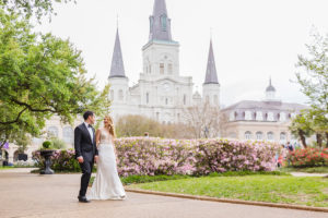 Alex and Greg walk thru Jackson Square in New Orleans' French Quarter on their wedding day. | photo by Studio Tran