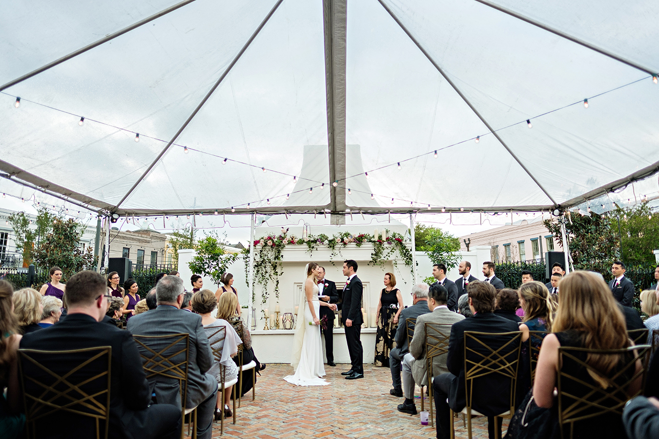 The wedding ceremony took place in Il Mercato's courtyard under a clear tent.