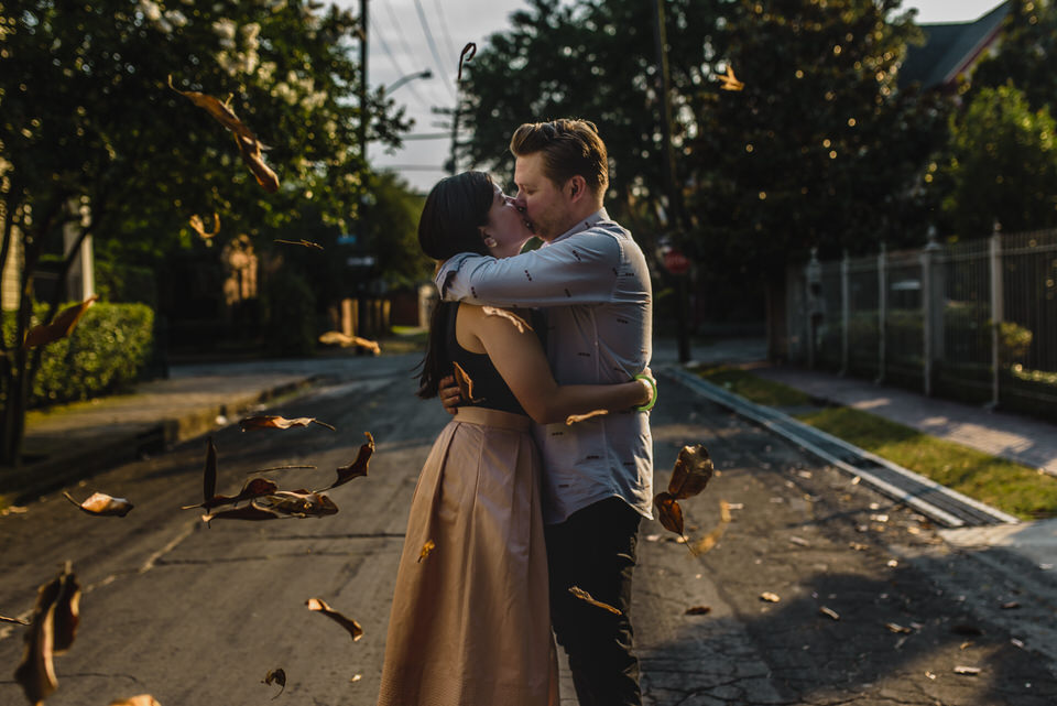 Magnolia leaves catch the wind in this engagement portrait in New Orleans' Garden District. | Photo by Sarah Alleman Photography.