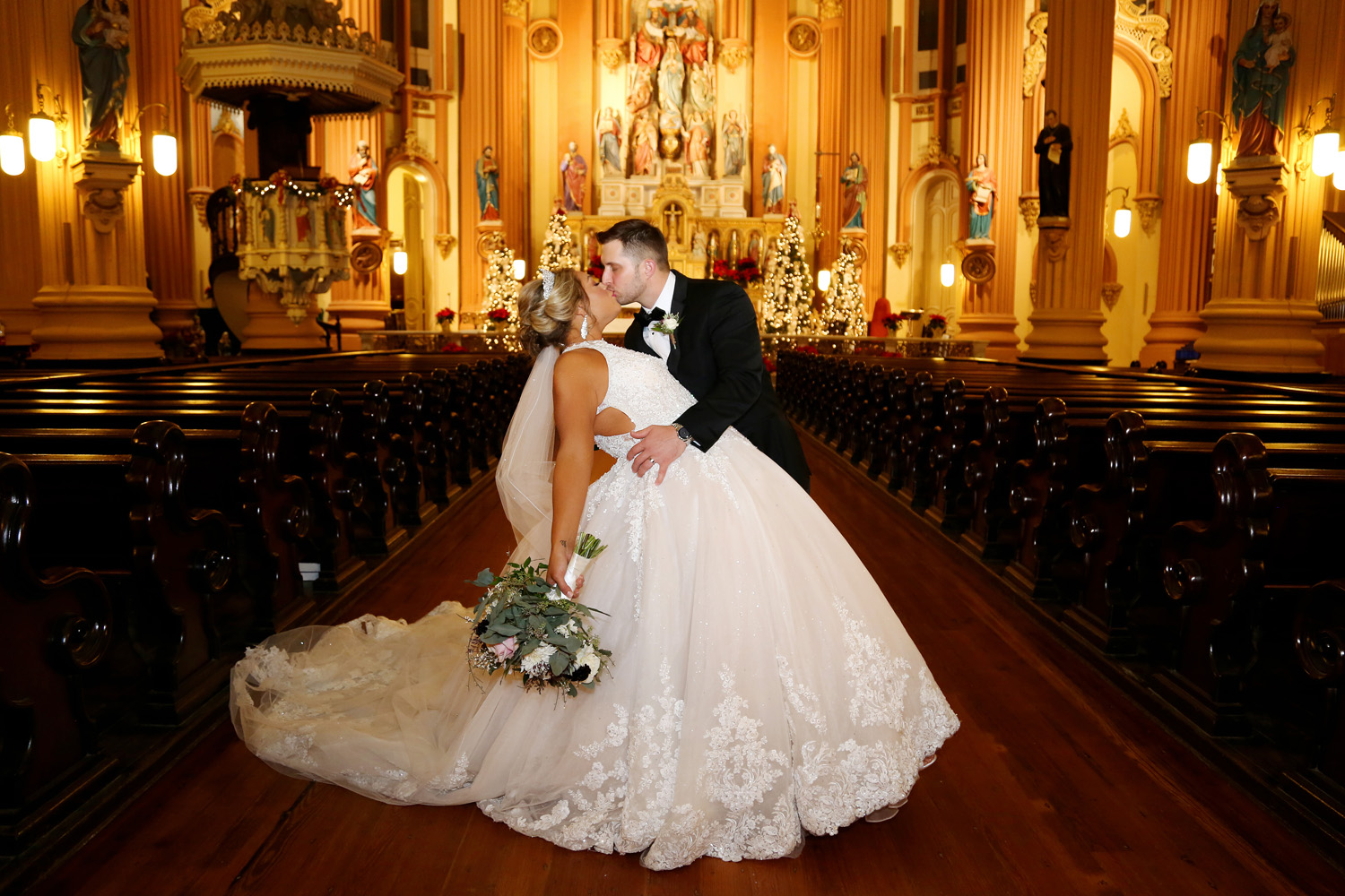David And Courtney Stop For A Kiss After Their Wedding Ceremony At St. Mary's Assumption Church In New Orleans.