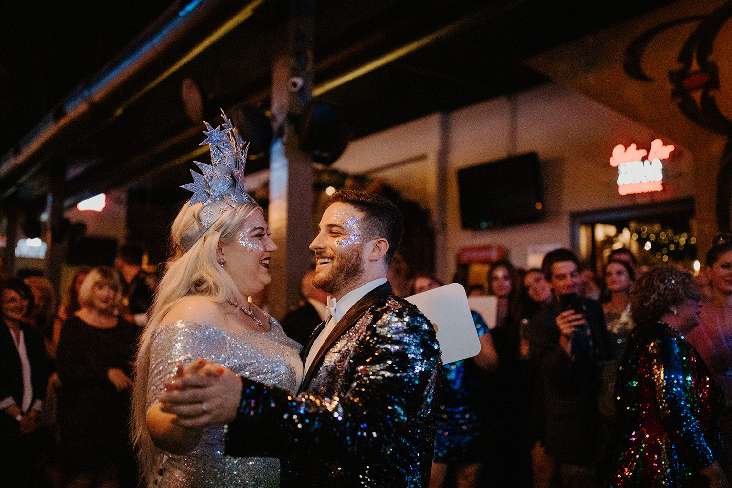 A couple wearing glitter from the Glitter Buffet dance. Photo: Gabrielle Hail