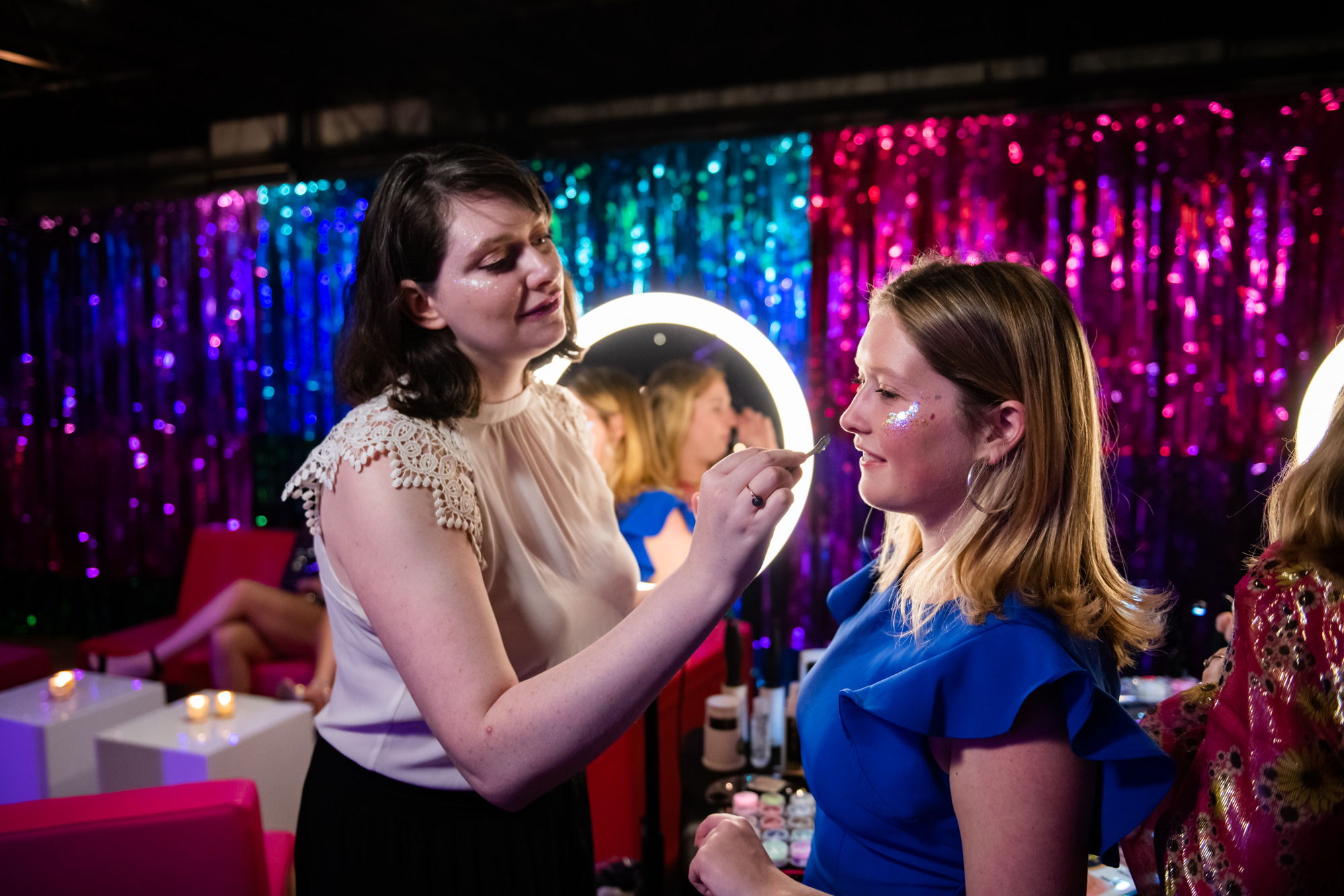 A guest gets glittered at the Glitter Buffet. Photo: Scott Myers