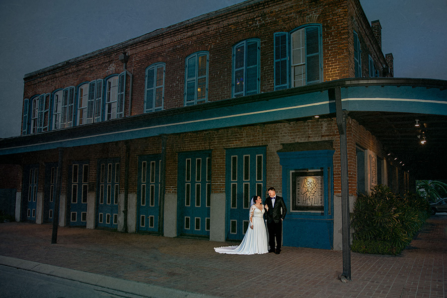 Jen and Jason took a few moments to take photos together before the wedding. They were sure to grab a photo outside their venue, Rosy's Jazz Hall.