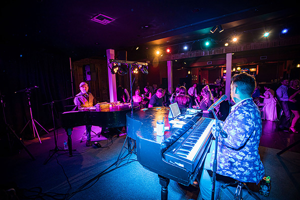 Dueling pianos at Rosy's Jazz Hall wedding reception. Photo by Brian Jarreau Photography
