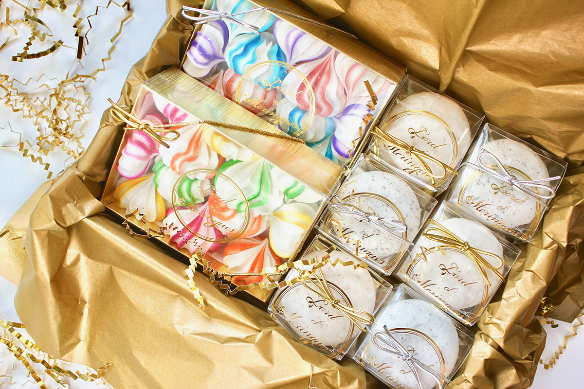 Boxes of colorful meringue kisses and meringue cookies by Lord of Meringues