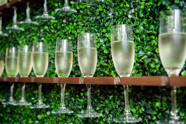 Nola Grace Decor's champagne hedge wall detail. Photo: Brocato Photography Collective