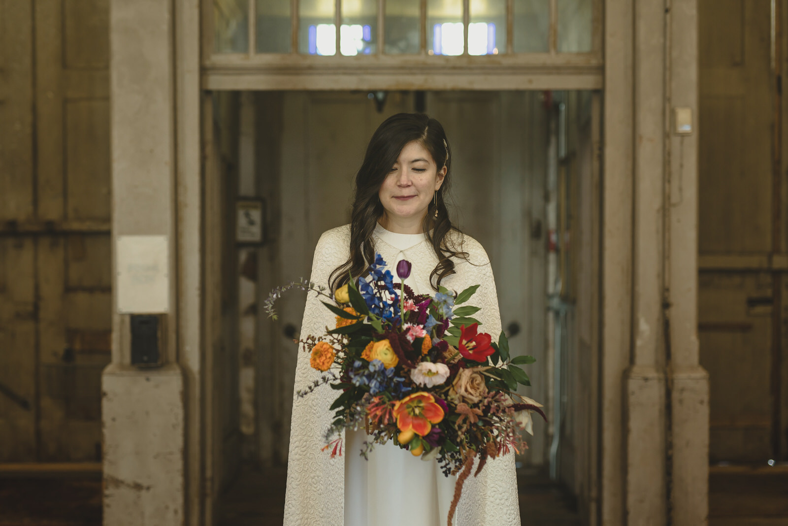 Bride with colorful bouquet. Photo by The Swansons