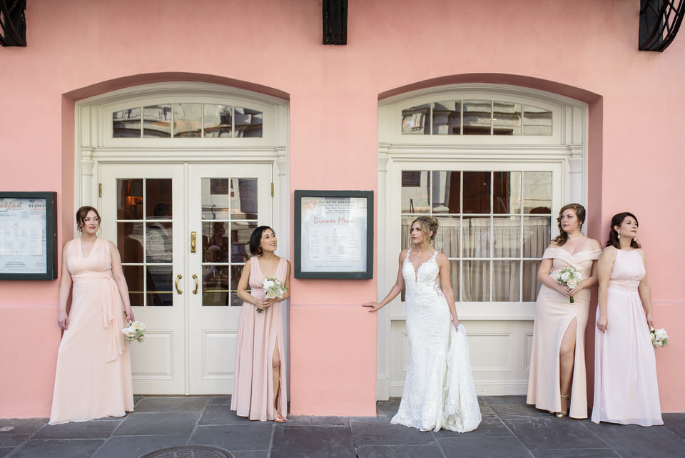 Bride and bridesmaids in New Orleans French Quarter. Photo by The Swansons