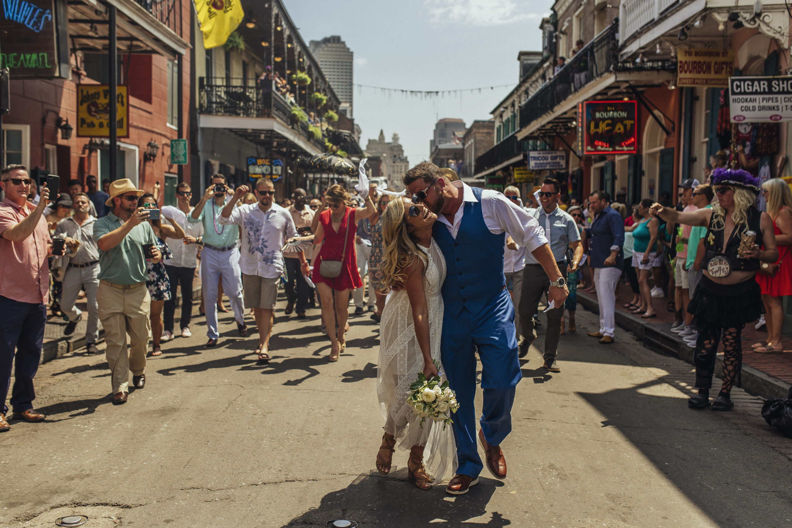 Newly married couple on Bourbon Street, New Orleans. Photo by The Swansons