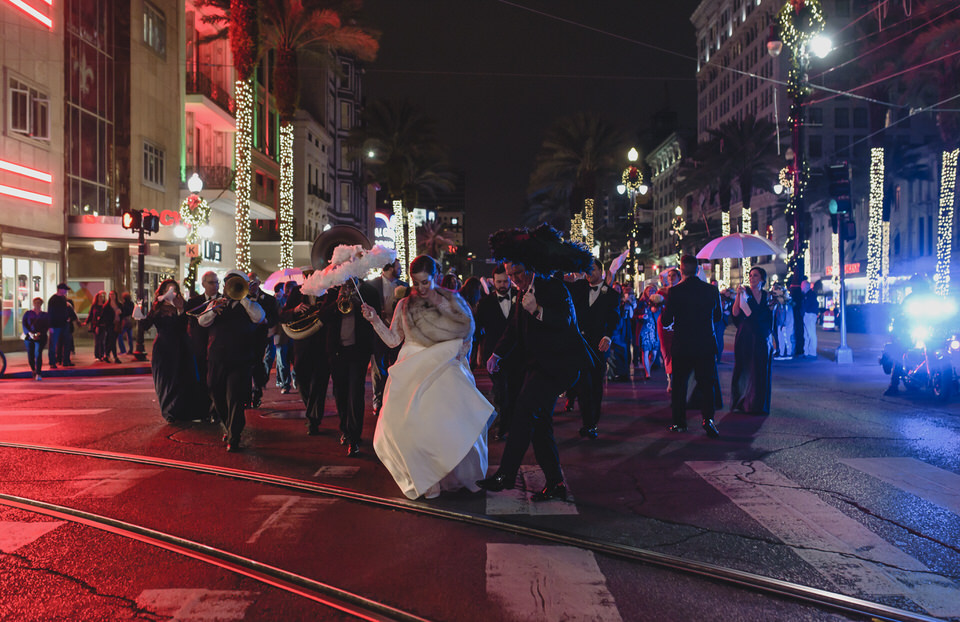 New Orleans wedding second line at night on Canal Street. Photo by The Swansons