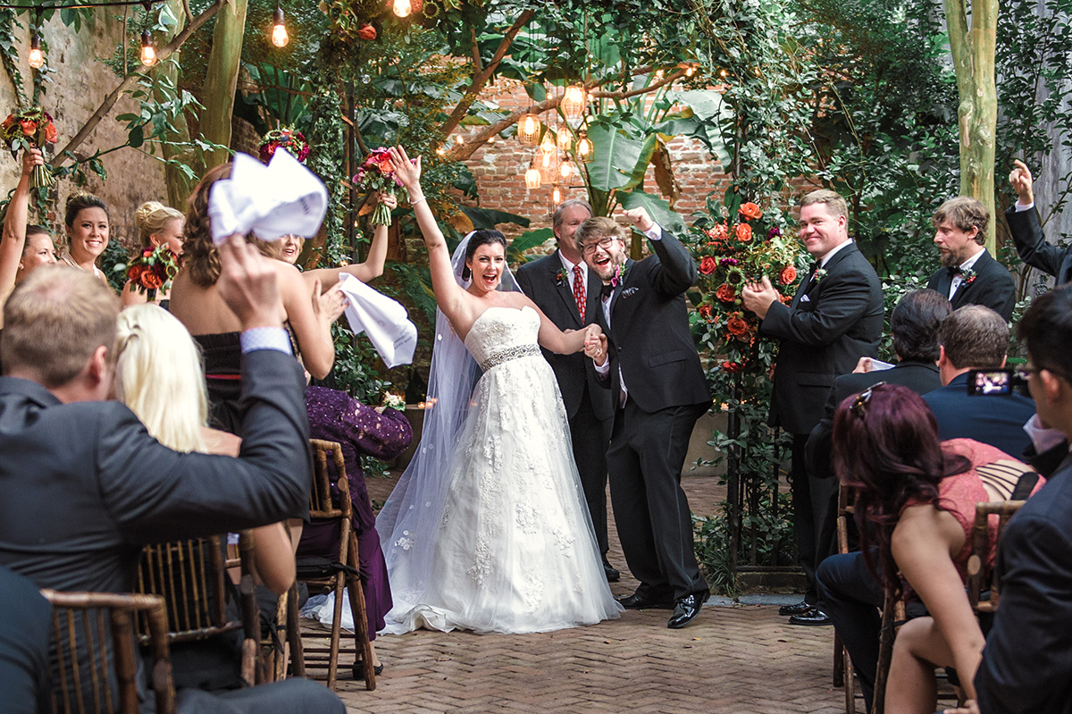 A newly married couple celebrates at The New Orleans Pharmacy Museum. Photo by The Red M Studio