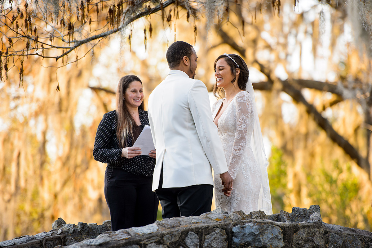 An intimate wedding on a bridge in New Orleans City Park. Photo by The Red M Studio