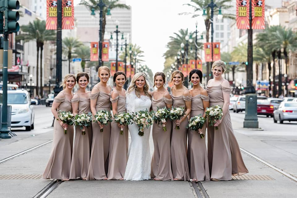 Bride with Bridesmaids on Canal Street in New Orleans. Photo by Studio Orleans Photography