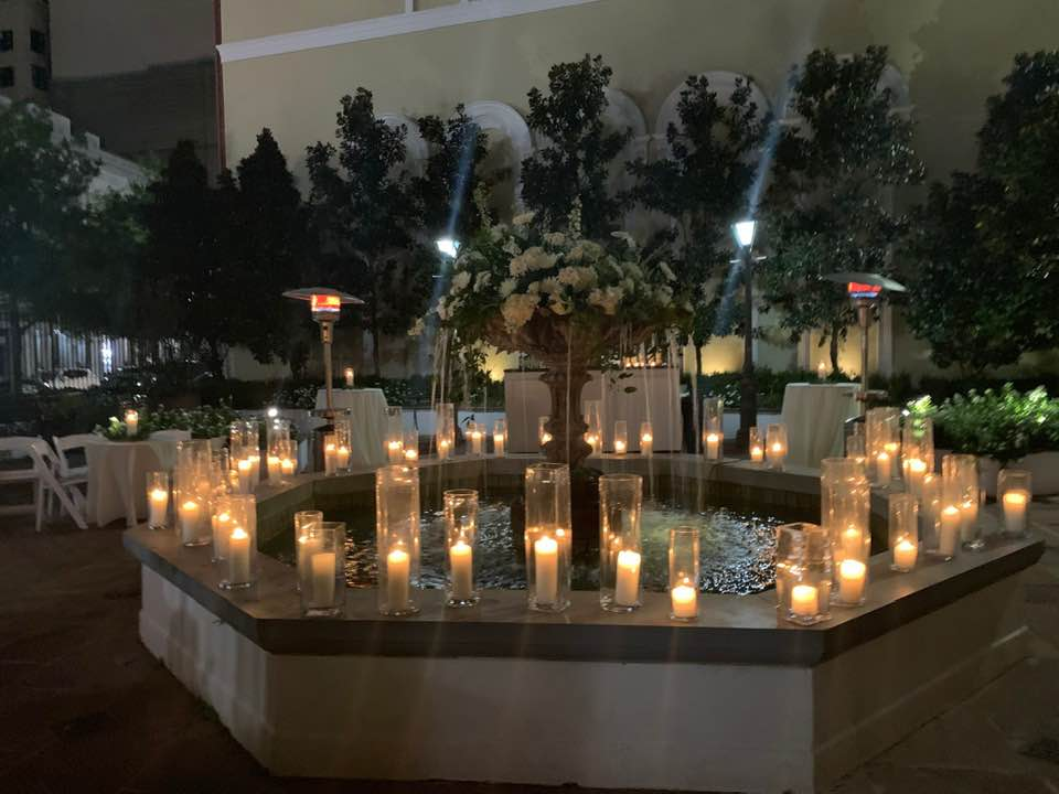 Courtyard Fountain with candles and flowers by Beth's Flowers