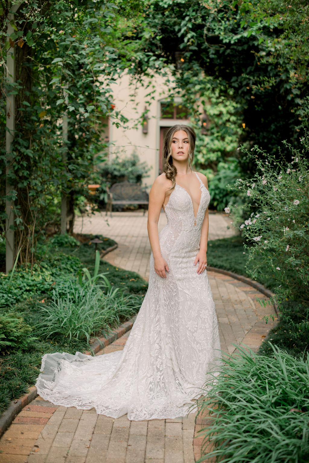 Bride wearing bridal gown with floral motif from I Do Bridal Couture. Photo: Emily Songer Photography