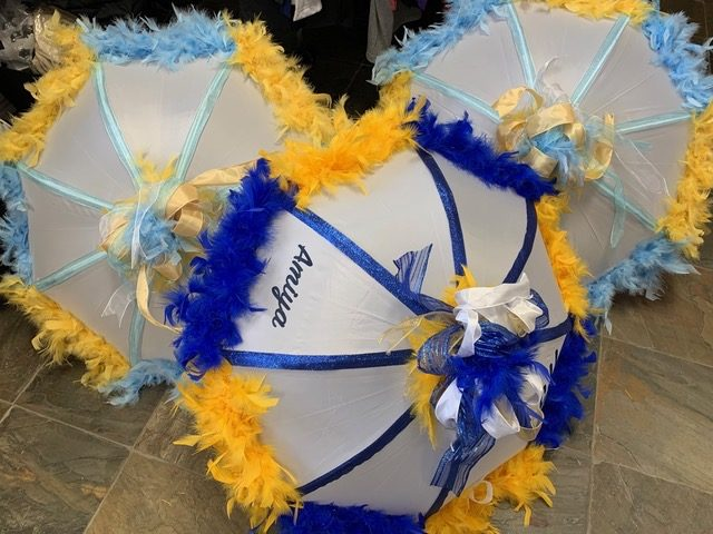 Second line umbrellas with feathers by Second-line Handkerchiefs