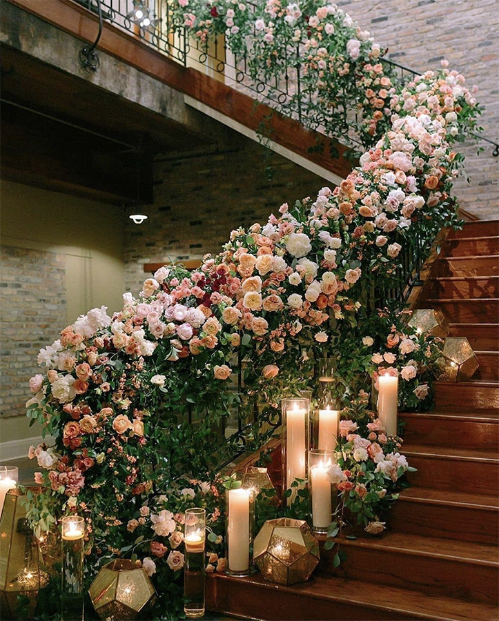The Chicory's staircase decorated with flowers and candles. Photo: Greer Gattuso
