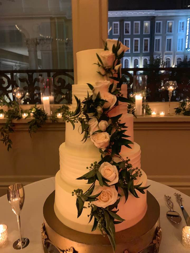 Wedding cake with fresh flowers by Beth's Flowers