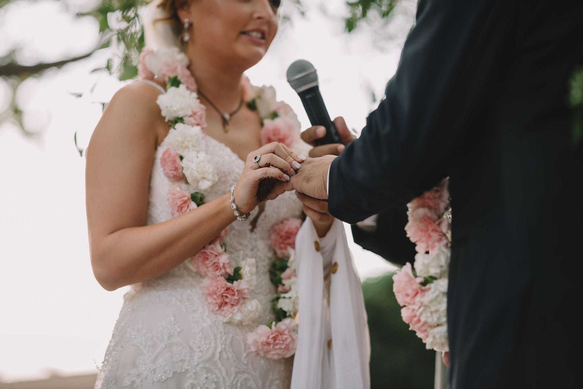 Rachel and Jimmy exchange wedding rings.