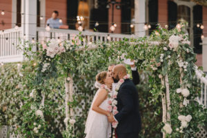 Rachel and Jimmy kiss under the Mandap at their wedding at Compass Point. Photo: Rare Sighting Photography