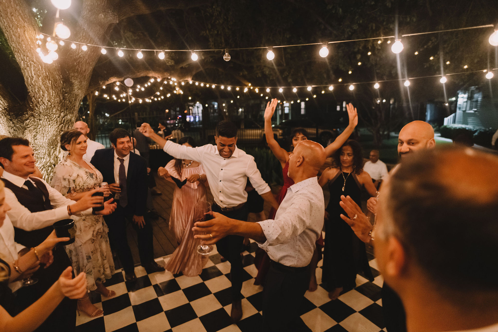 Guests dance and enjoy the reception.