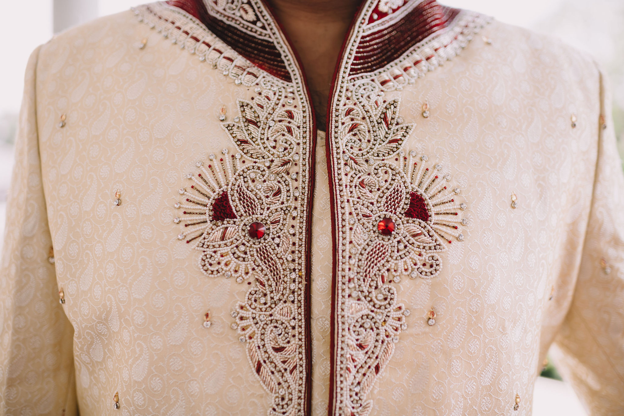 Jimmy wore a Sherwani with red embroidered detail.