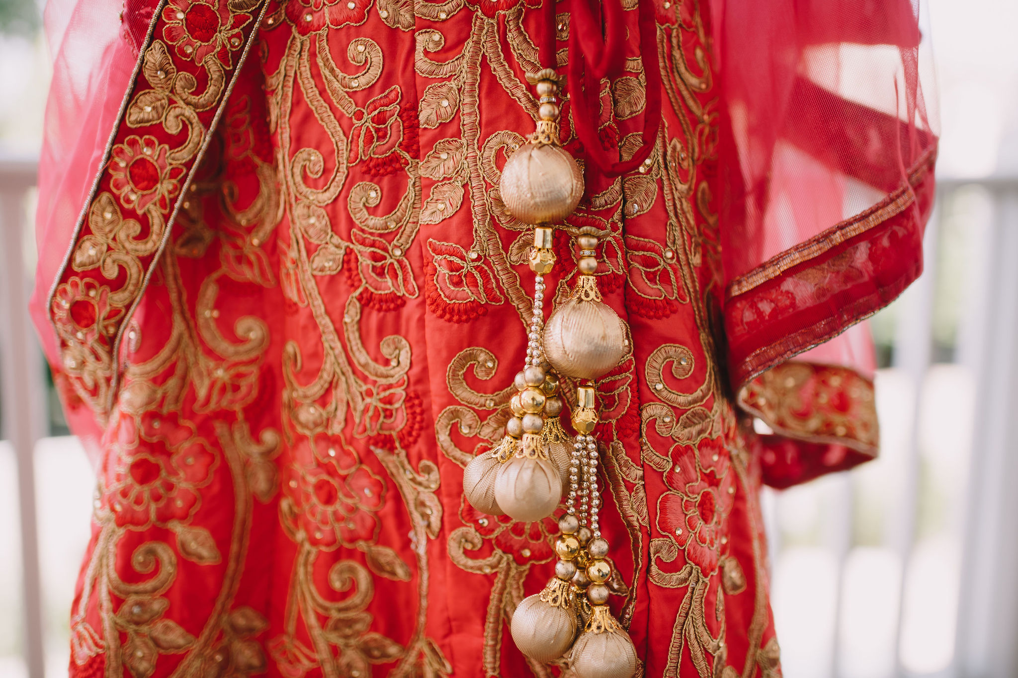 Rachel and Jimmy's wedding weekend included a Mehndi Party. For this event, Rachel wore a traditional Lehenga in red and gold.